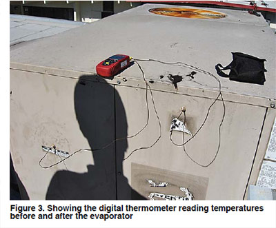 Figure 3. Showing the digital thermometer reading temperatures before and after the evaporator.